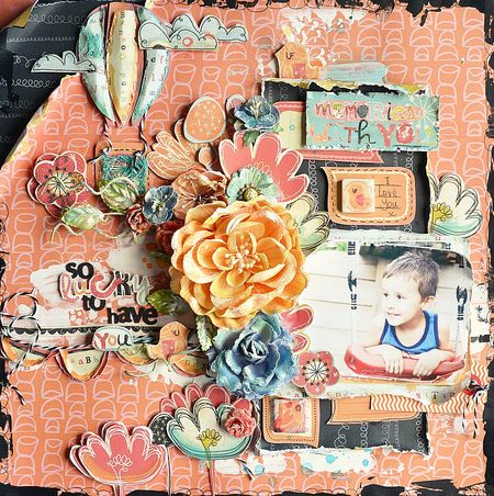 Her page using prima patterned papers and a blend of colorful flowers