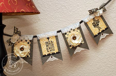 of course you need a banner for halloween cut pieces out of prima paper string on our ribbon and decorate for a stunning centerpiece - Non Scary Halloween Decorations